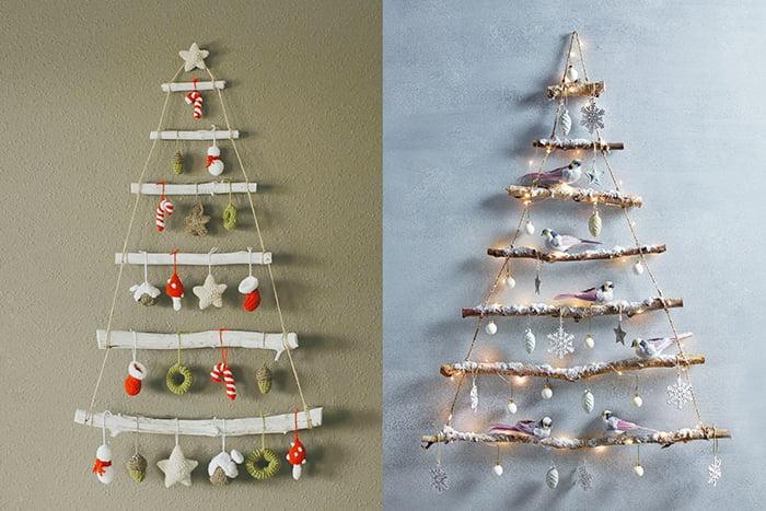 Новогодние елочки из палок на стене