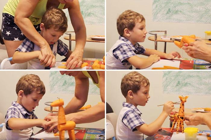 Мама с ребенком делают жирафа из моркови
