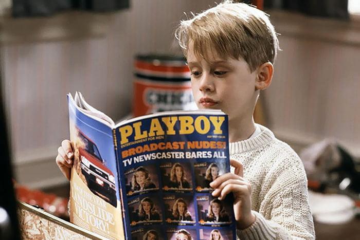 Мальчик читает Playboy